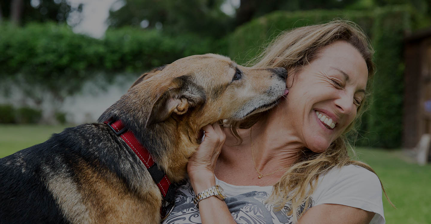 Woman playing with dog for brain health