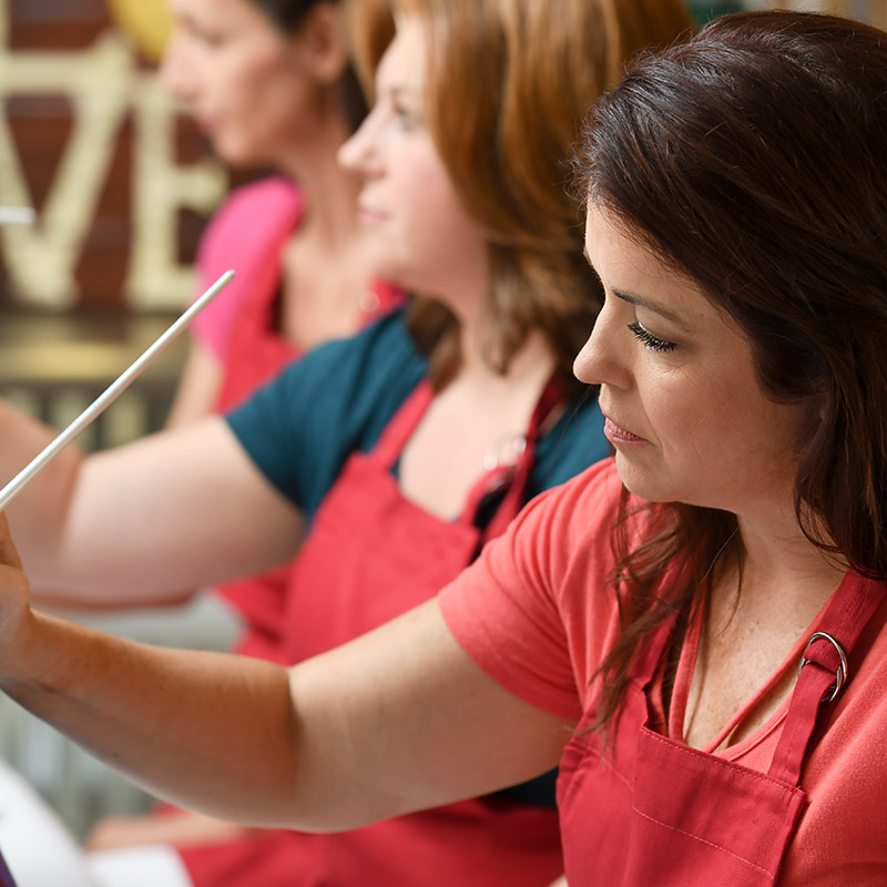 Woman taking painting classes to exercise her brain