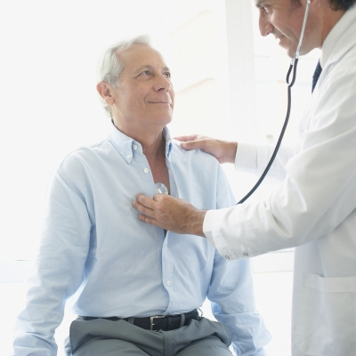 Man having lungs checked by a physician.